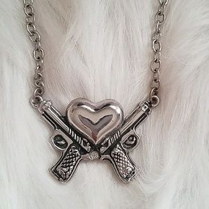 Super cute silver heart with guns necklace